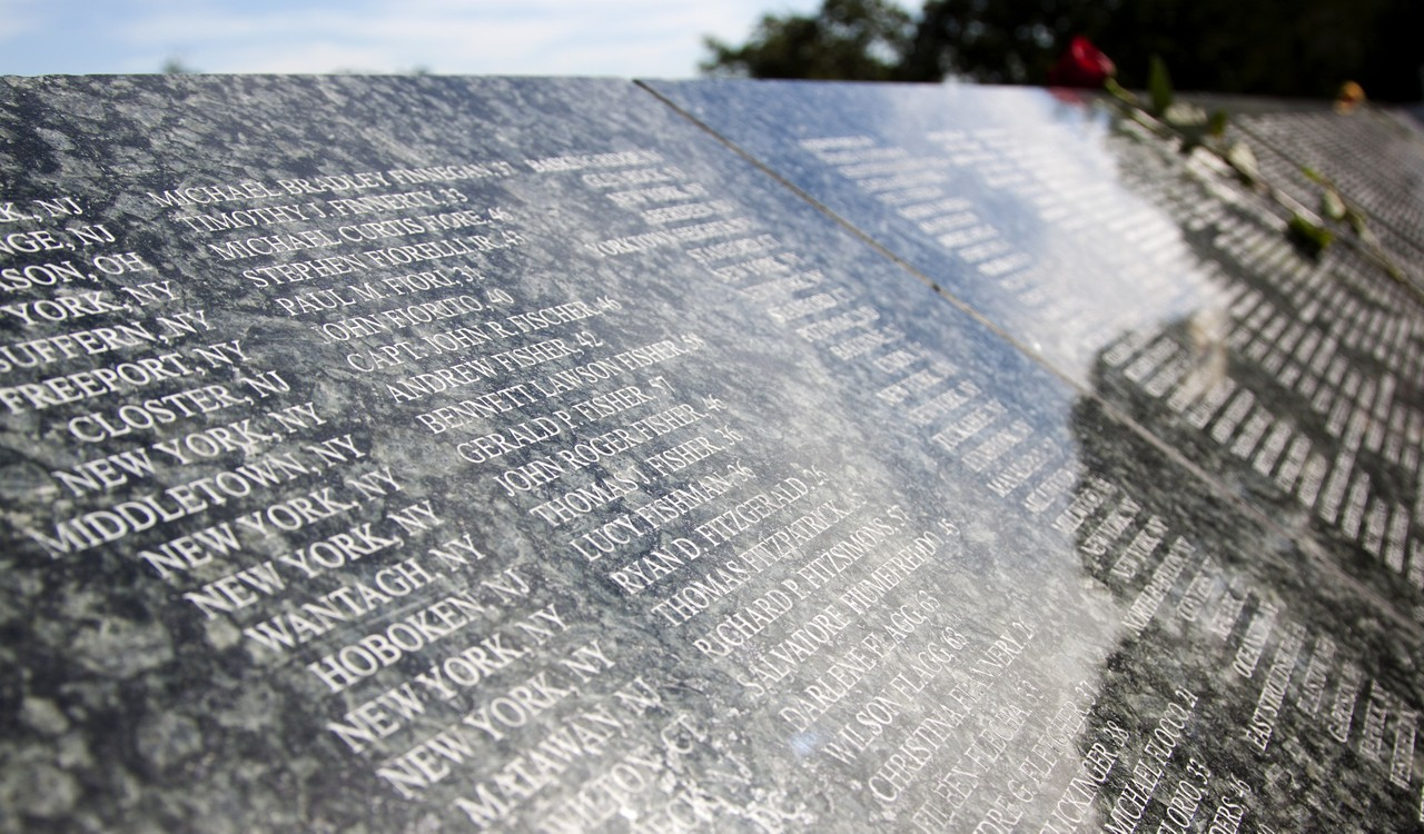 A 911 memorial granite wall with names etched on it inside Eagle Rock Reservation,in West Orange, NJ, honours victims of the 2001 terror attacks, seen in 2012. Photo: Glynnis Jones/Shutterstock.