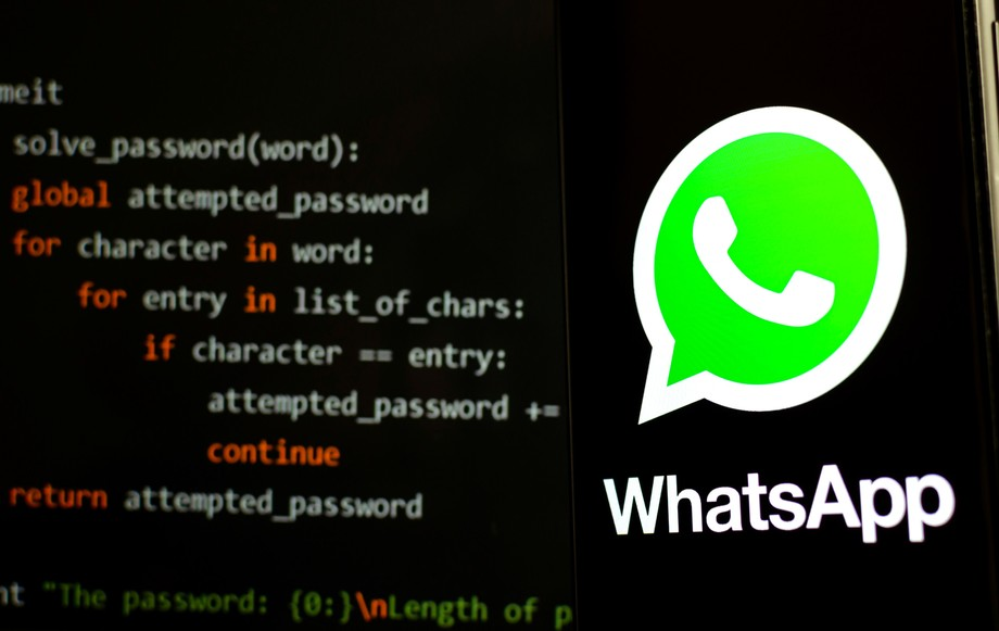 Stone, Staffordshire / UK - October 29, 2019: WhatsApp logo on the smartphone in a dark room and piece of Python code for brute force at the blurred background. Illustrative for WhatsApp hack news. (c) 2019 Ascannio/Shutterstock.