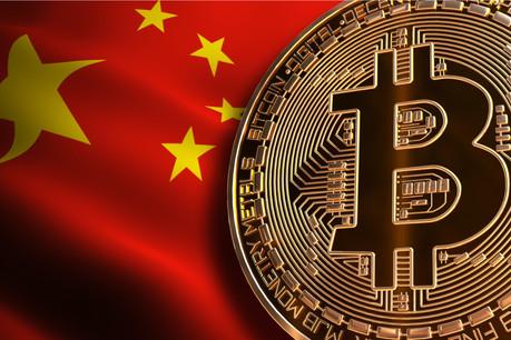 Seule reste autorisée, en Chine, la détention de bitcoins. Il valait mieux, puisque l'empire du Milieu concentre une grande partie de l'industrie du minage. (Photo: Shutterstock)