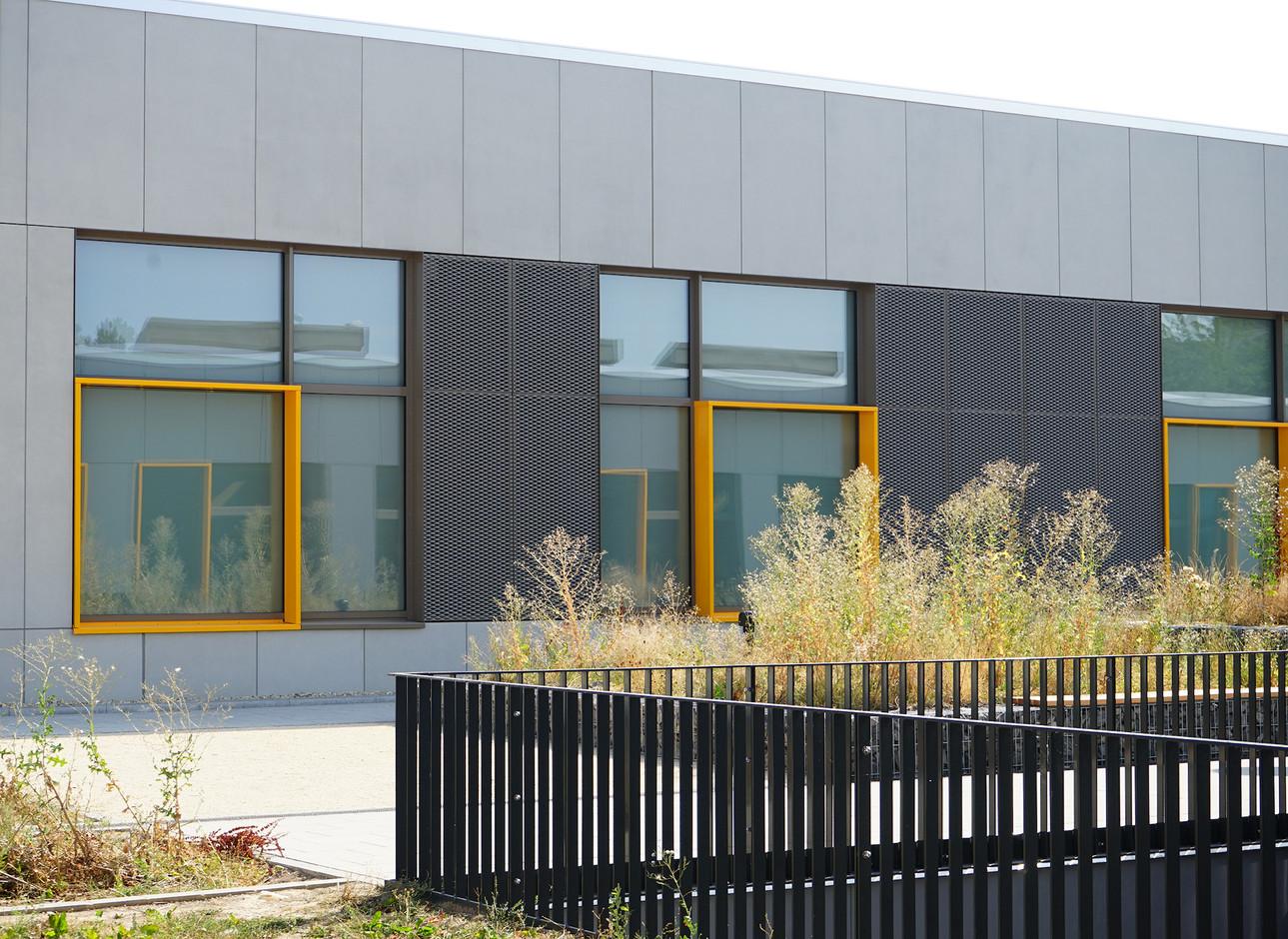 The yellow window frames form a visual signature.                      (Decker, Lammar & Associates)