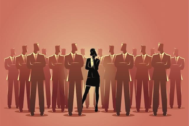 businesswoman_standing_among_businessmen-web.jpg