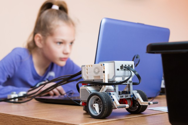 A girl is pictured coding a robot in Belarus Shutterstock