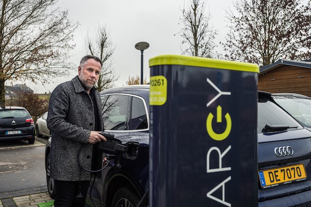 Chair of the British Chamber of Commerce in Luxembourg Daniel Eischen is pictured plugging in his electric hybrid Mike Zenari