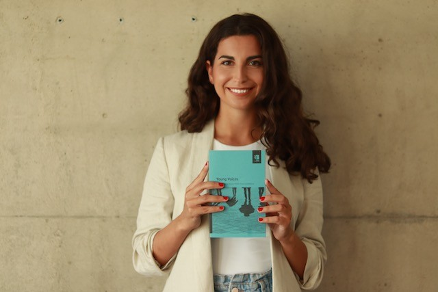 Winner of the 20-26 age category Amela Skenderovic is pictured holding a copy of the new anthology in which her short story is featured Amela Skenderovic