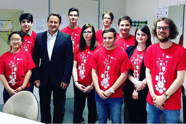 The Luxembourg team poses for a photograph with the prime minister, Xavier Bettel, before they left for the First Global robot contest in Washington Madhumalti Sharma