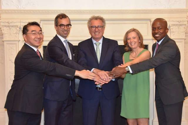 Pierre Gramegna, centre, surrounded by representatives from the 4 winning fund management firms Finance ministry