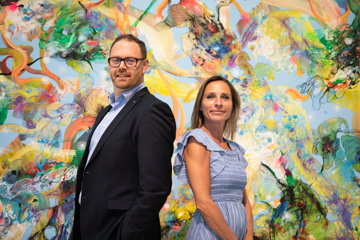 Jeffrey Dentzer, Chief of Luxembourg Market & CIB etLore Bertrand, Channels Business Delivery & Digital Adoption. They are standing in front of Régénération, a 2021 acrylic on canvas by Samuel Lévy.  Maison Moderne