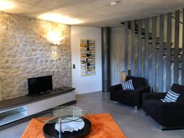 Au deuxième étage, le salon en demi-cercle, comme le reste de l'habitation. ((Photo: Paperjam.lu))