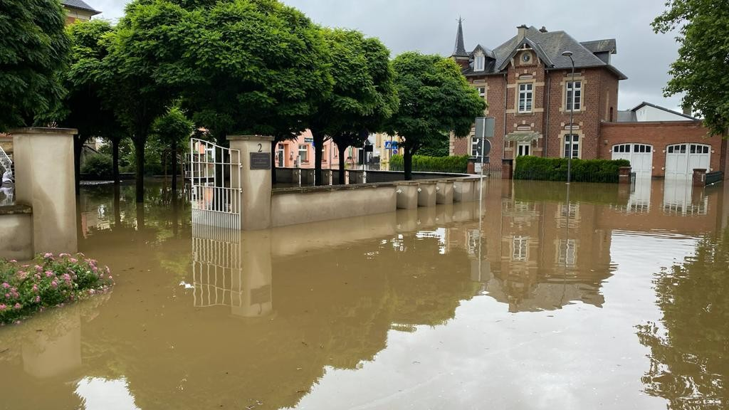 A 15 July 2021 photo shows the street outside the CNL in Mersch submerged in muddy flood water Photo: CNL