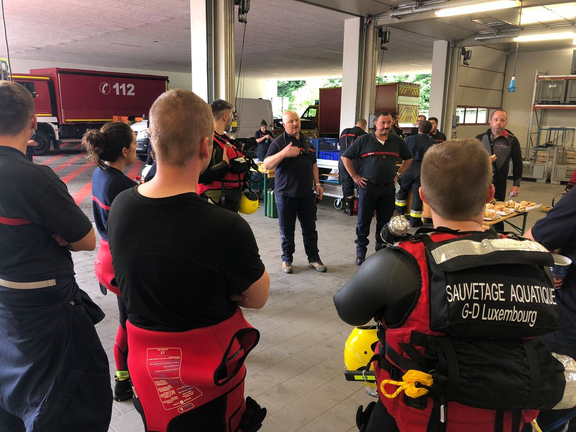Rescue workers are seen planning the evacuation of flooded residents in Echternach, 15 July 2021. CGDIS