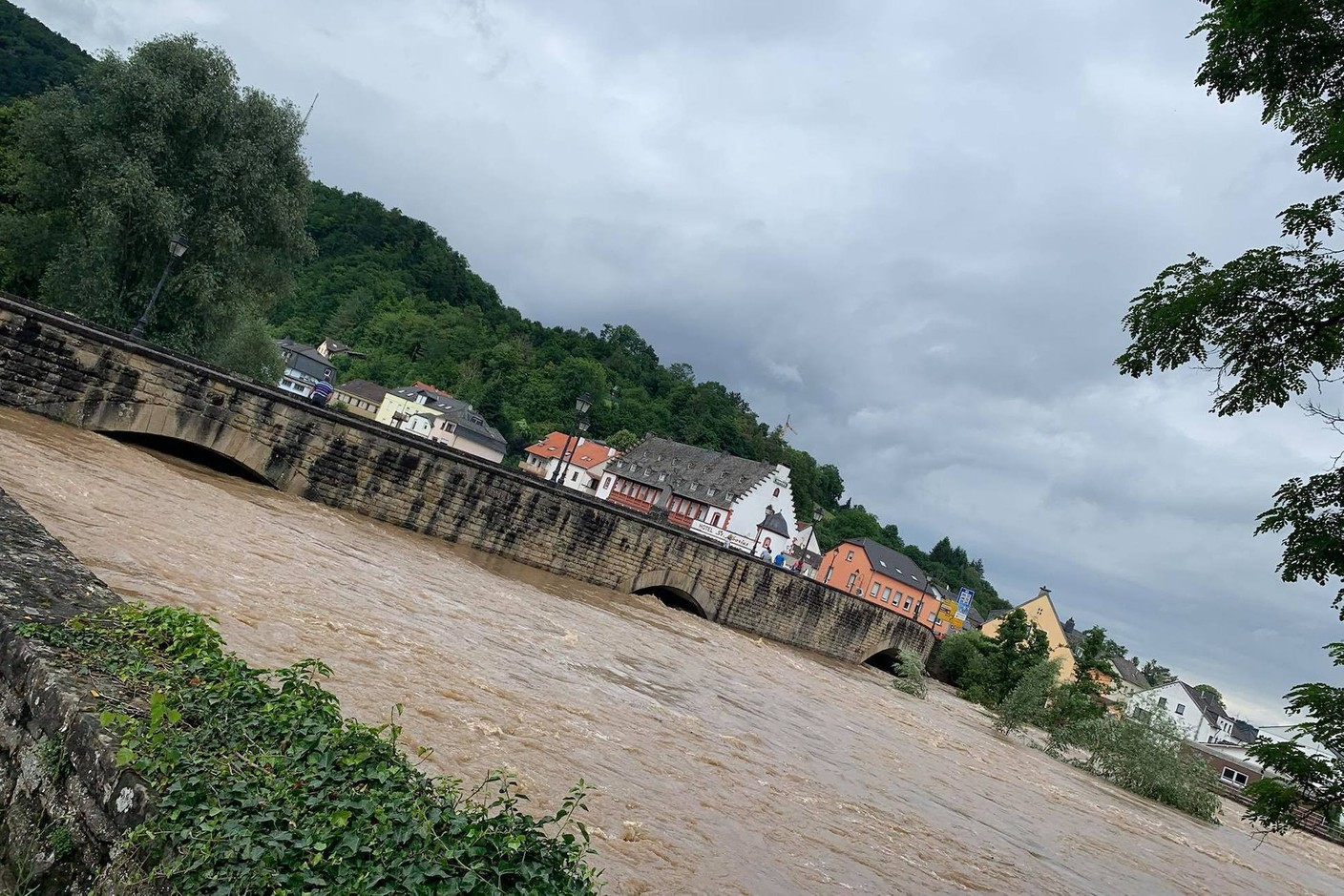 A view taken from the Luxembourg side of the Echternach Bridge and the rising Sauer, 15 July 2021. Photo: Lisa Grisius