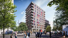 La tour de logements présente une façade colorée. ((Illustration: QuickIT_Steinmetzdemeyer))