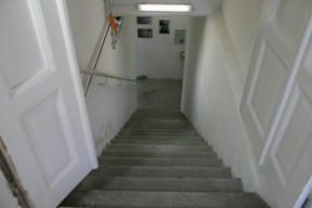 Stairs leading to the basement where prisoners were kept by the Gestapo Matic Zorman / Maison Moderne