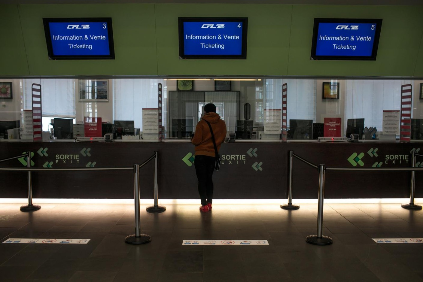 Library picture: A traveller is seen at the CFL ticket counter inside the central train station, May 2020. Photo: Matic Zorman