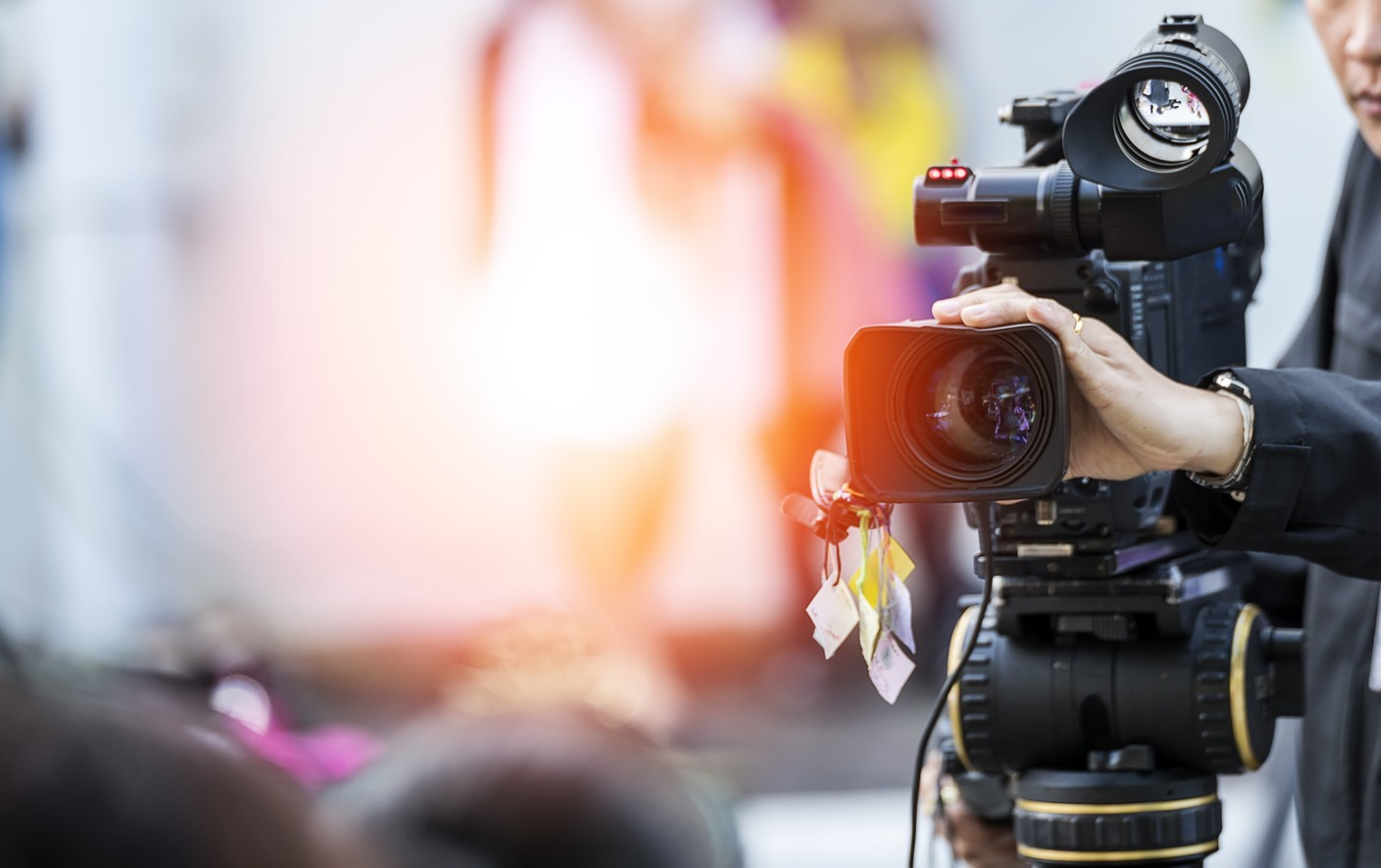 Video camera operator working with his equipment Shutterstock
