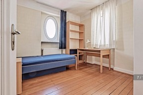 One of the smaller bedrooms, which was used for student housing, seen before renovation work started. Photo provided by Aatika Hayat