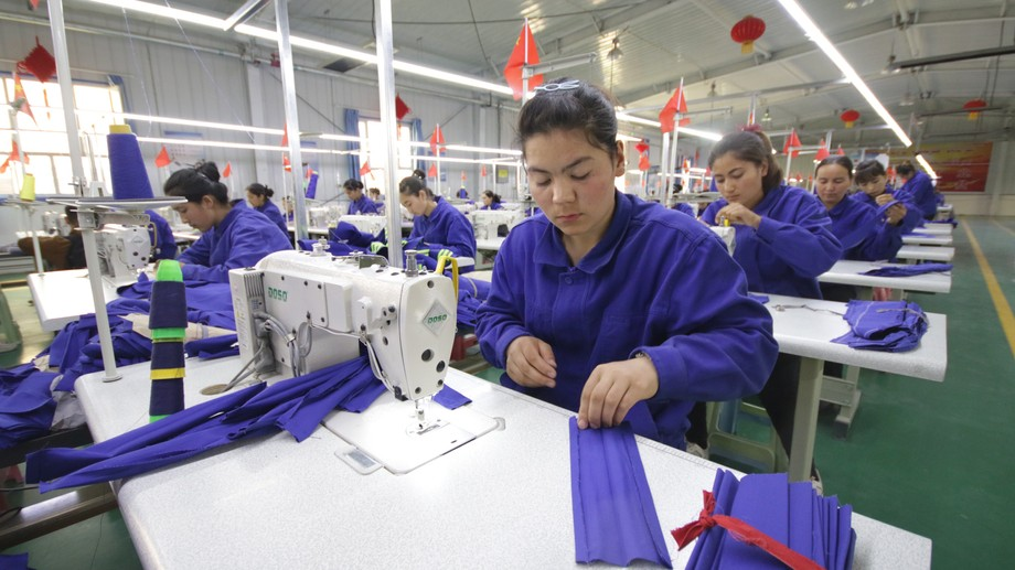 Uyghur women working in a cloth factory in Hotan county, Xinjiang province, China – April 2019. Copyright (c) 2020 Azamat Imanaliev/Shutterstock.