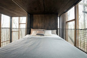 The bedroom in the Glass Cube.  Ici