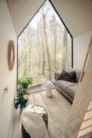 The cocooning corner of the Flying Farmhouse.   Ici