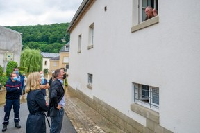 Xavier Bettel, the prime minister (DP), and Taina Bofferding, the interior minister (LSAP), are seen inspecting Born, located along the Sauer river in eastern Luxembourg, 15 July 2021. SIP / Jean-Christophe Verhaegen