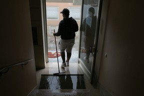 Cleaning up after flooding in Luxembourg City's Weimerskirch district, 15 July 2021. Matic Zorman / Maison Moderne