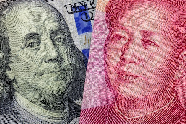 Close up of one hundred Dollar and 100 Yaun banknotes with focus on portraits of Benjamin Franklin and Mao Tse-tung / USA vs China trade war concept. Photo: Lyxor ETF