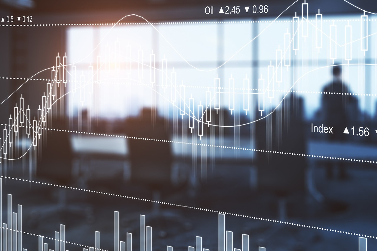 Thoughtful businessman in blurry filtered meeting room interior with abstract forex chart. Fund management concept. Double exposure  (Photo: ©peshkov)