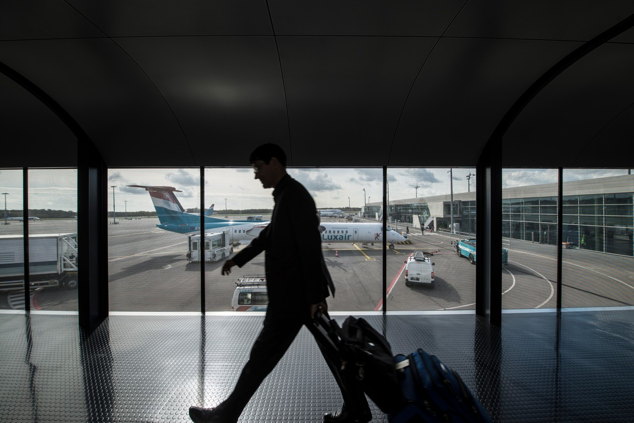 A Luxair plane can be seen from the terminal of Luxembourg's airport in Findel Photo: Anthony Dehez