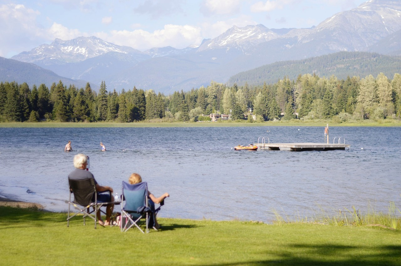 A retired couple watches Alta Lake in Whistler, Canada, in 2019 Photo: Max Harlynking / Unsplash