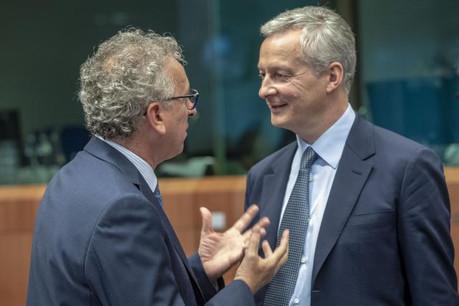 Pierre Gramegna (de dos) et Bruno Le Maire devraient trouver un compromis sur cette épineuse question pour le Luxembourg (ici en discussion à Bruxelles en juillet dernier). (Photo: Conseil européen / archives)