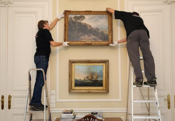 Staff installing a painting at the British ambassador's official residence  Steve Eastwood