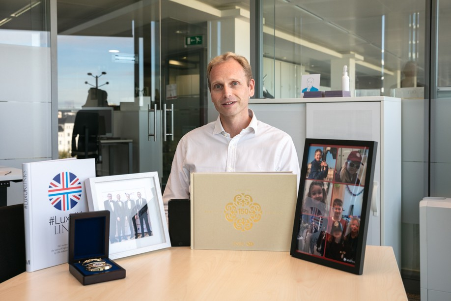 Niccolo Polli, CEO of HSBC in Luxembourg, is seen sitting at the meeting table in his office with 6 items that adorned his workspace when Delano visited in mid-October. Photo credit: Romain Gamba