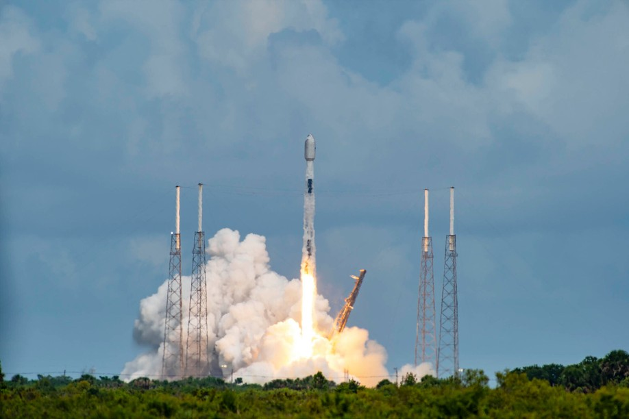 The SpaceX Falcon 9 rocket is pictured during lift-off at Cape Canaveral, USA, on 30 June carrying 88 satellite within a rideshare mission known as Transporter-2. Among those satellites is OQ Technology's Tiger-2 satellite OQ Technology