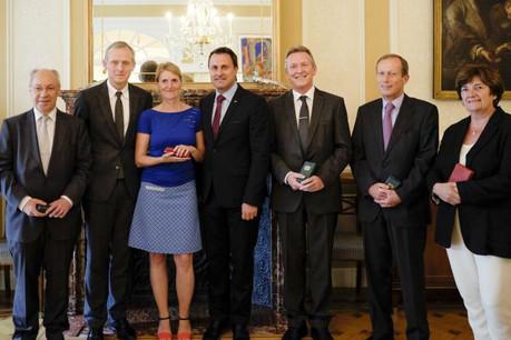 De gauche à droite: Alain Crepin, Paul Dujardin, Jeanne Brunfaut, Xavier Bettel, Erik Hermans, Vincent Delwiche et Michèle Detaille  (Photo: SIP)