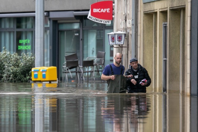 People wading up to their waist in flood waters on the place d'Argent in Luxembourg City on Thursday 15 July 2021 Matic Zorman
