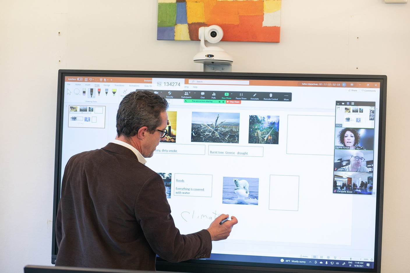 He completes their answers on his interactive board. (Photo: Matic Zorman/Maison Moderne)