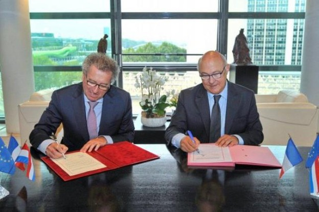 Pierre Gramegna et Michel Sapin mettent fin à un bug fiscal entre la France et le Luxembourg. (Photo: MFIN France / P. Vedrune)