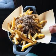À choisir parmi les savoureux «sides» du Scott's: des frites à la truffe. (Maison Moderne)