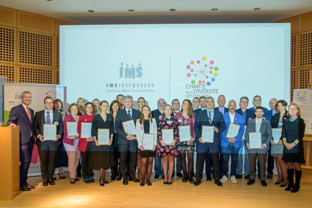 Les 23 nouveaux signataires de la Charte de la diversité Lëtzebuerg. (Photo: Charles Caratini et Michel Brumat pour IMS Luxembourg)