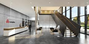Un grand hall vitré accueillera les visiteurs et donnera accès aux bureaux situé dans l'anneau au moyen d'une volée d'escaliers. (Albert Speer + Partner)