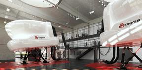 Le hall vitré est dimensionné pour abriter trois simulateurs de vol dédiés à la formation des pilotes. (Albert Speer + Partner)