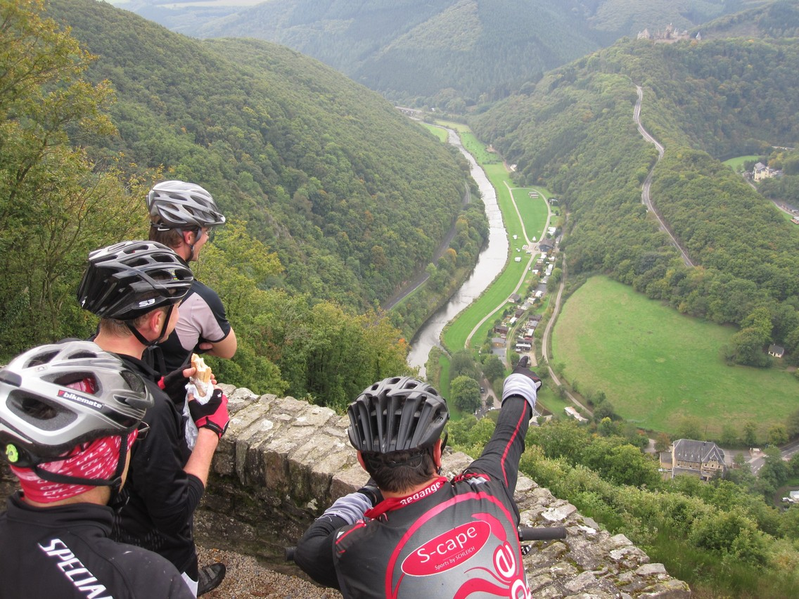 McQuaide's cycling friends enjoy the view over Bourscheid valley Mike McQuaide