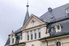 Gable windows adorn the top of the residence Romain Gamba/Maison Moderne