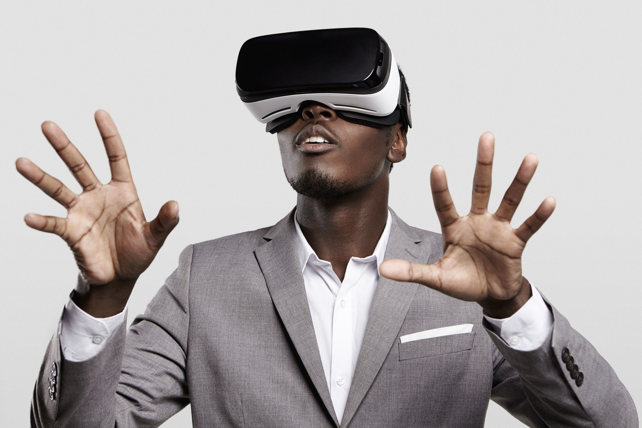 Illustration photo shows a man wearing formal suit and virtual reality headset. Photo: Shutterstock