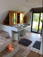 One of the home's bathrooms is seen before renovations. Photo provided by Batipol