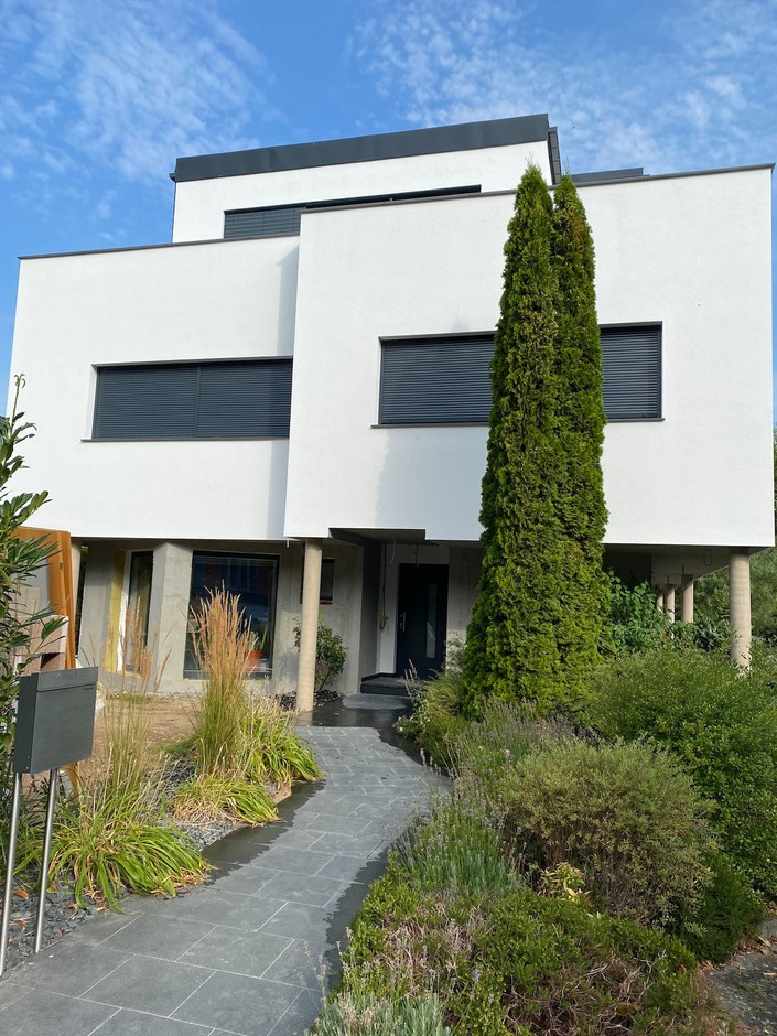 The exterior of this home in Ernster is seen following the completion of a total makeover and major expansion, that more than tripled its surface area, which finished in 2021. Photo provided by Batipol