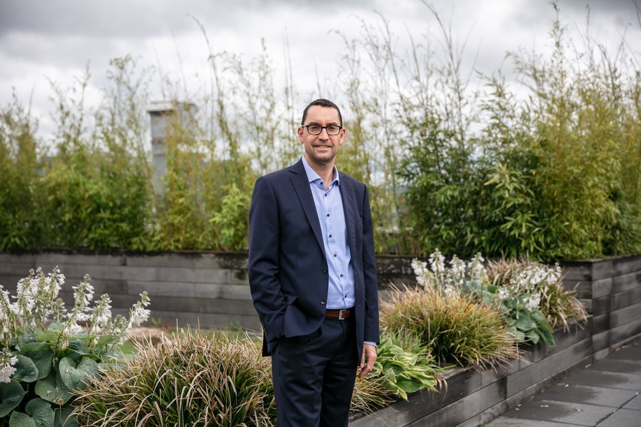 """Yves Cheret, head of fund services Luxembourg at CSC Global Financial Markets, pictured on the rooftop terrace of """"The Station"""" building in Strassen. Romain Gamba/Maison Moderne"""